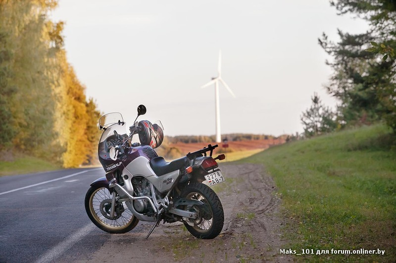 Honda Transalp and wind-generator about the lake Naroch